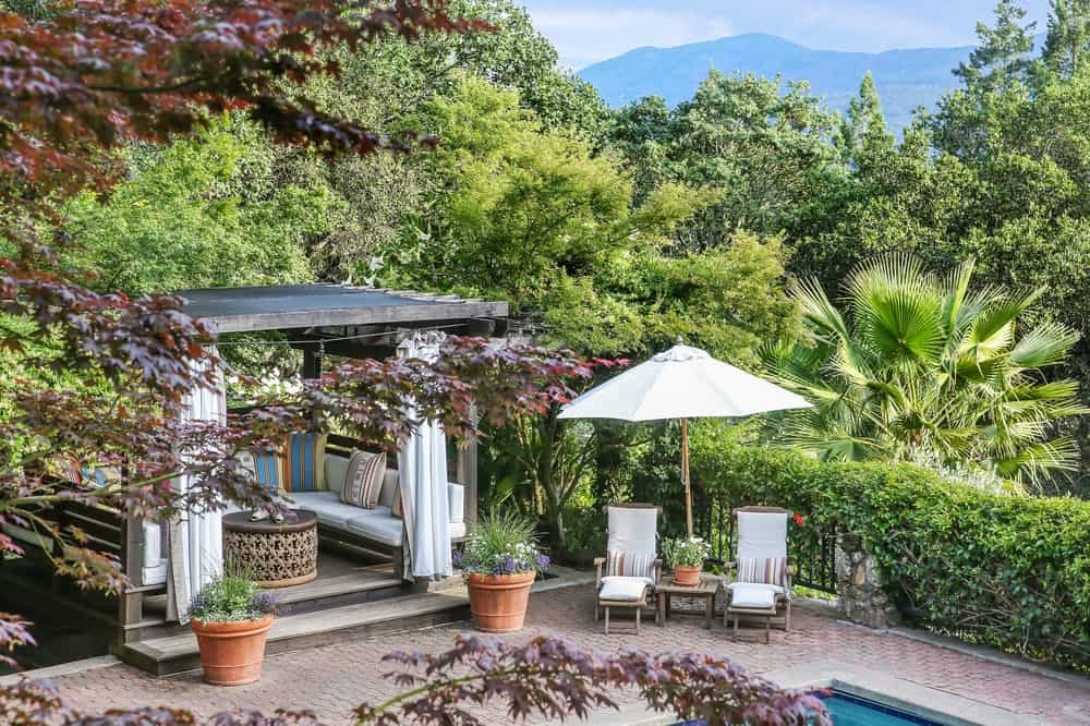 This overlooking view of the pool side area shows the charming terracotta brick walkways around the pool with a couple of comfortable sitting areas. Images courtesy of Toptenrealestatedeals.com.