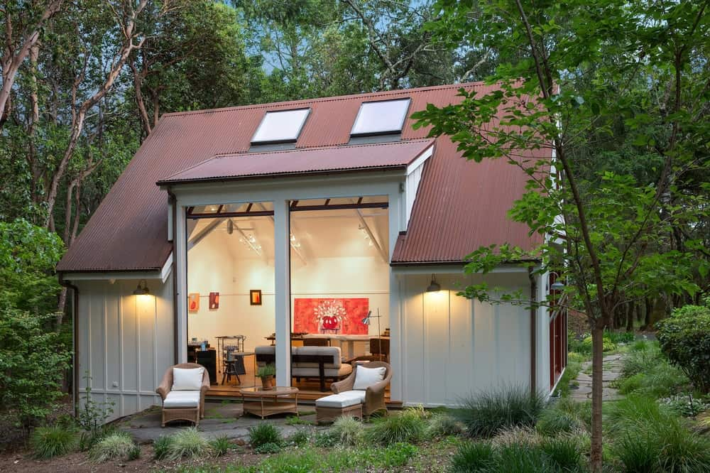This is the large building dedicated for the workshop and art studio. It has a couple of arm chairs outside to enjoy the beautiful landscaping. Images courtesy of Toptenrealestatedeals.com.