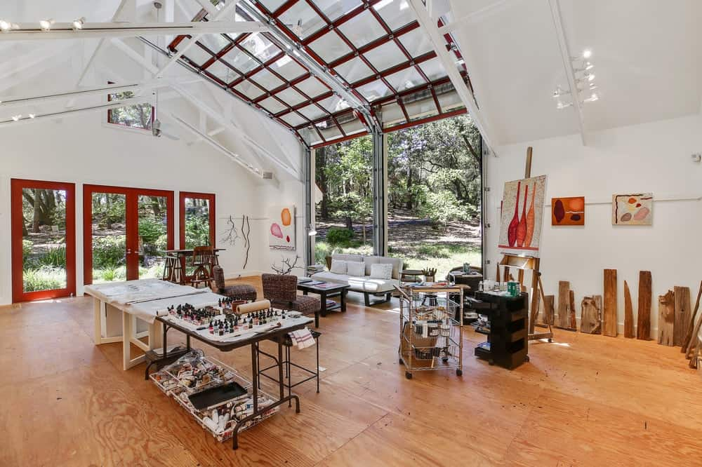 This is the interior of the large workshop and art studio with two roll up garage doors that lets in natural lights as well as provide a nice background for inspiration. Images courtesy of Toptenrealestatedeals.com.