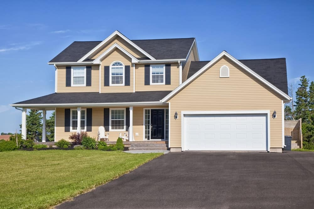 Large family home with yellow exterior siding.