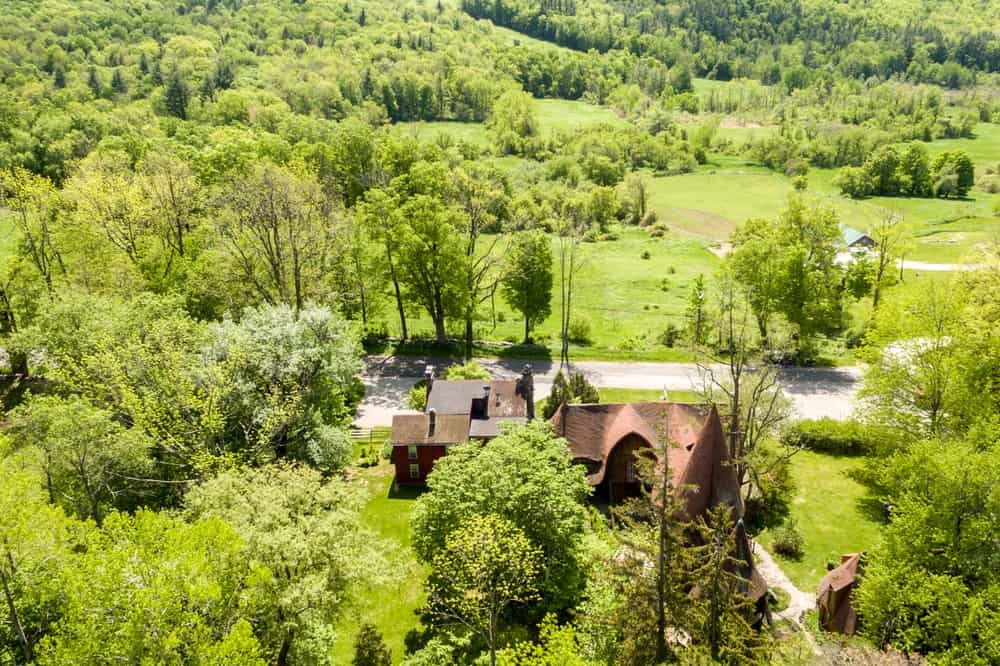 This is an aerial view of the compound showing the lush vegetation and landscape that surrounds the four houses of the compound. Images courtesy of Toptenrealestatedeals.com.