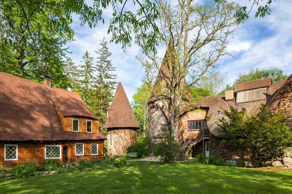 This is a view of the proximity between the Gingerbread house and the studio. Seeing the two unique houses together seems to augment the magical vibe of the compound. Images courtesy of Toptenrealestatedeals.com.