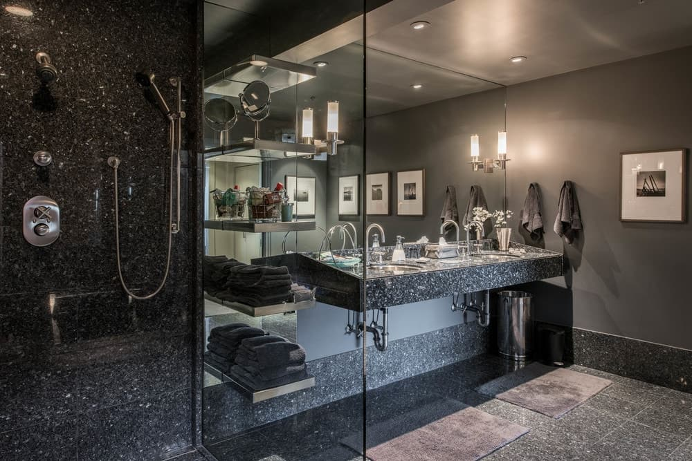 Beside the vanity is the glass-enclosed shower area that the same sark marble walls as the vanity making the fixtures stand out. Images courtesy of Toptenrealestatedeals.com.