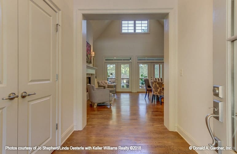 Across the foyer is the great room with cathedral ceiling and french doors.