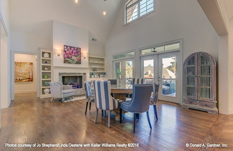 The great room offers multiple seats and a fireplace flanked by built-in shelves.