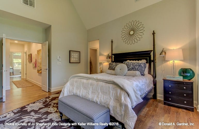 The opposite side view shows the french door that opens out to the hallway leading to another bedroom.