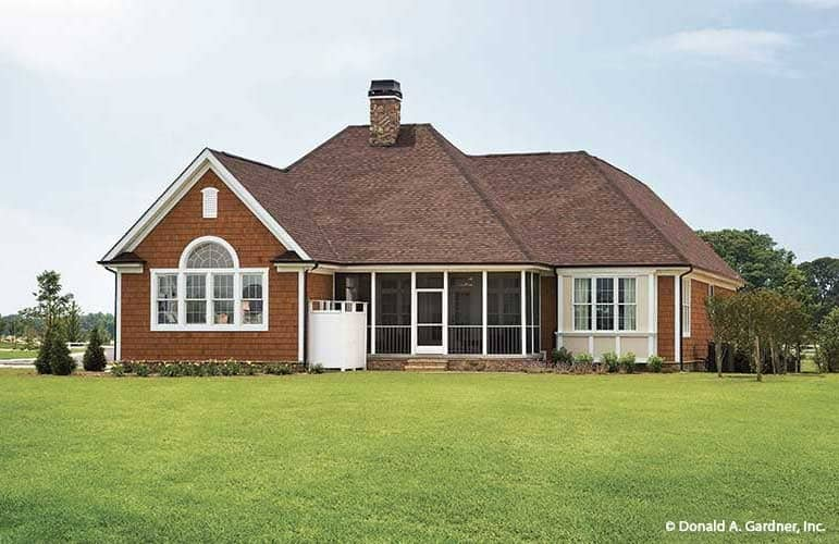 Home's rear exterior view shows the hipped roofs, red brick cladding, and a screened porch.
