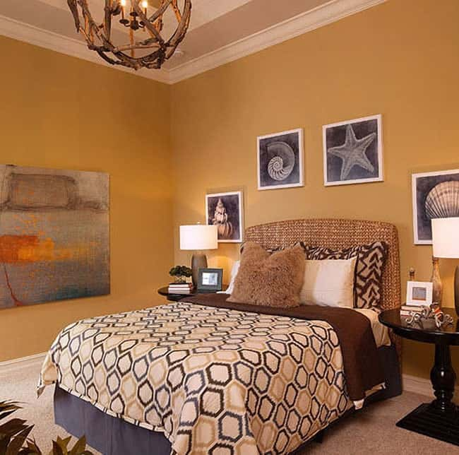 This bedroom features a wicker bed and a rustic spherical chandelier hanging from the tray ceiling.