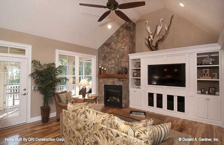 A built-in entertainment center next to the fireplace completes the living room.