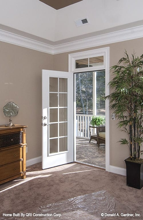 Bedroom's white framed door leading to the screened porch.