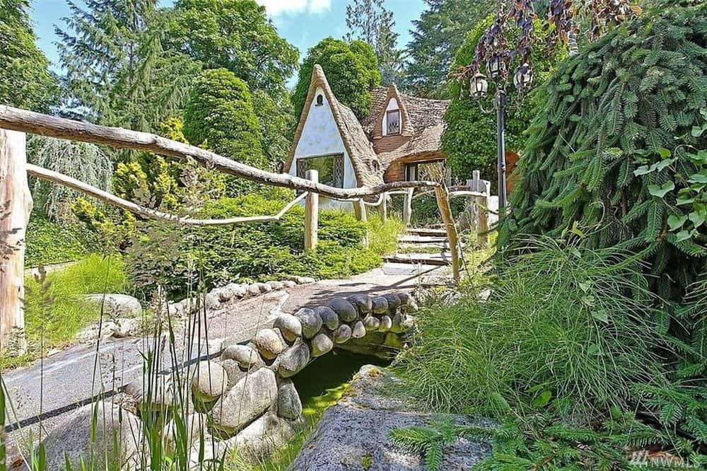 At the back of the house is a gorgeous and rustic stone bridge with charming wooden handles. Images courtesy of Toptenrealestatedeals.com.