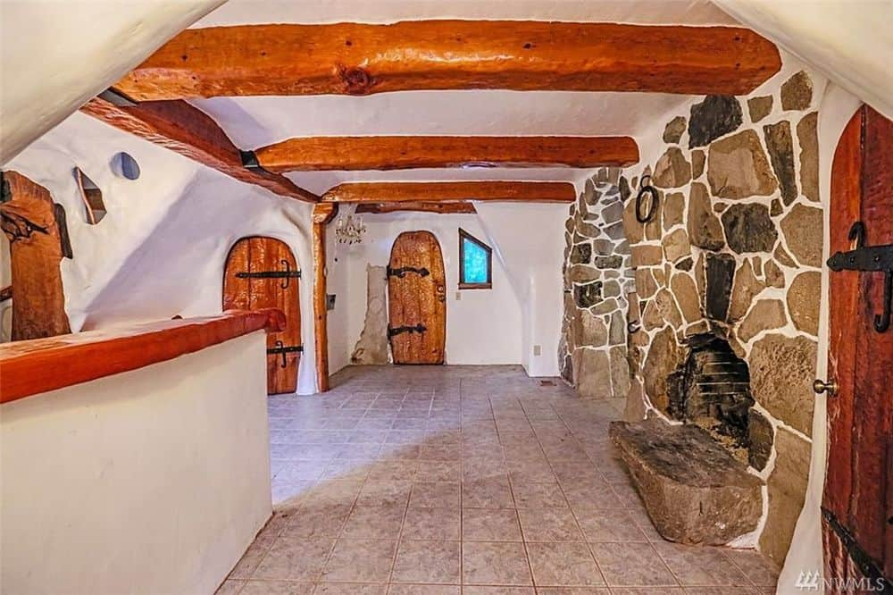 As you can see here, each door of the house has a different shape giving each one a unique look and it also adds to the rustic charm of the house. Images courtesy of Toptenrealestatedeals.com.