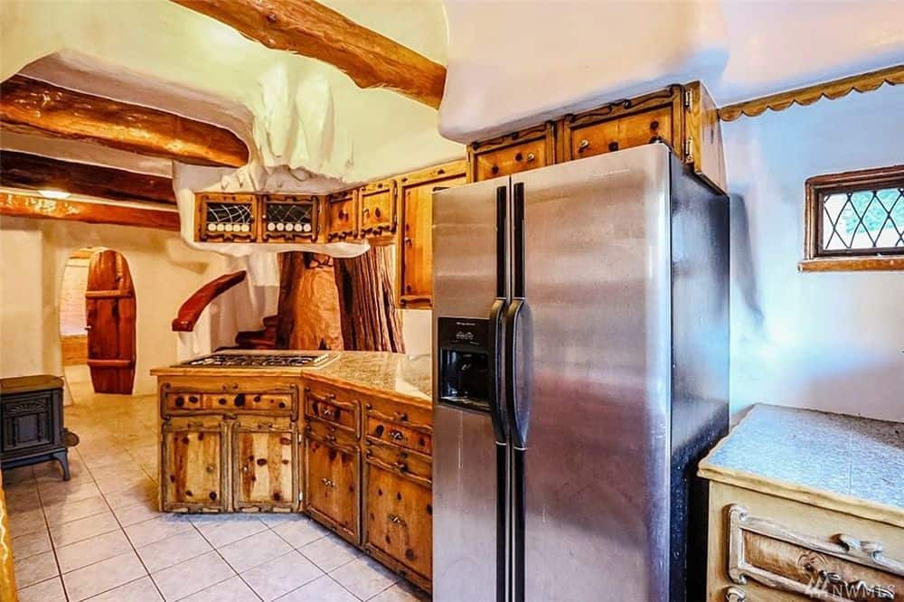The wooden cabinetry of the kitchen serves as a nice contrast for the stainless steel modern fridge making it the stand out element of the kitchen. Images courtesy of Toptenrealestatedeals.com.