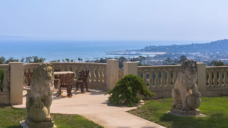 This is a closer view of one of those balconies. The concrete walkway is guarded by stone statues leading to beautiful outdoor chairs that surround a table with a wide sweeping view of the ocean below. Images courtesy of Toptenrealestatedeals.com.