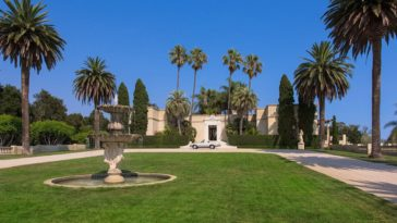 The elegant mansion has beige exterior walls that are complemented by the tall variety of trees framing it on all sides. This gorgeous home is also foregrounded with a large lawn of grass with a stone fountain in the middle. Images courtesy of Toptenrealestatedeals.com.