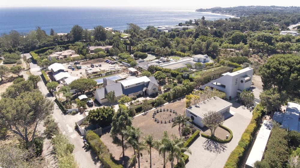 This far aerial view features the beautiful landscaping that surrounds the buildings and brings a dash of color to the section of the place. Images courtesy of Toptenrealestatedeals.com.