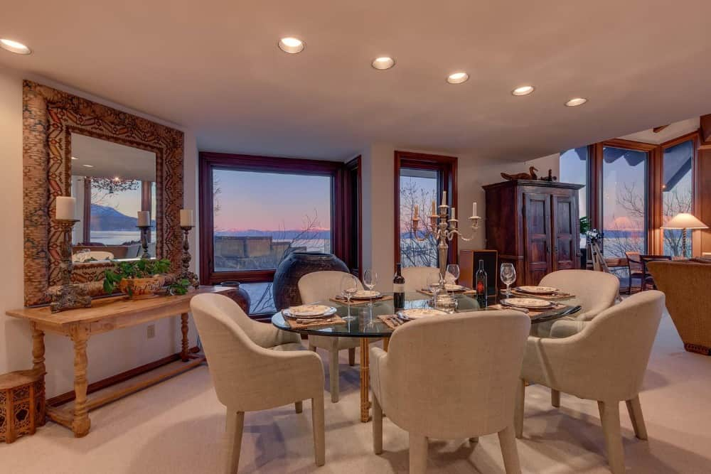 Another look at the oval-shaped glass top dining table paired with modern gray seats. Images courtesy of Toptenrealestatedeals.com.