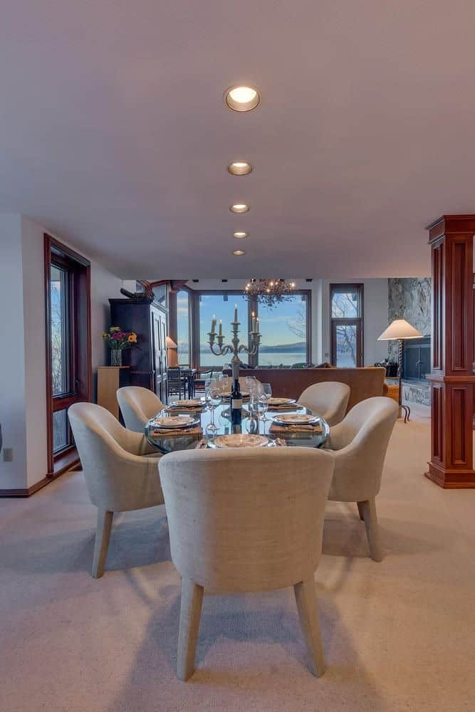 A much closer look at this oval-shaped glass top dining table along with its modish gray chairs. Images courtesy of Toptenrealestatedeals.com.