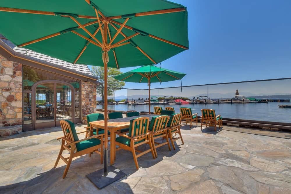 An outdoor dining set with an umbrella providing shade. The area offers wonderful view of the surroundings. Images courtesy of Toptenrealestatedeals.com.