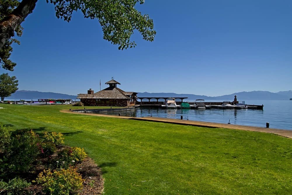 There's a lawn area that is well-maintained before reaching the property's dock. Images courtesy of Toptenrealestatedeals.com.