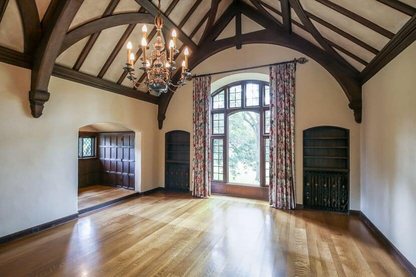 Here's the ballroom-sized great room featuring hardwood flooring and a tall ceiling with large exposed beams. Images courtesy of Toptenrealestatedeals.com.