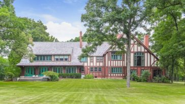 Another outdoor view of the house taken from the backyard, showcasing its amazing exterior. Images courtesy of Toptenrealestatedeals.com.