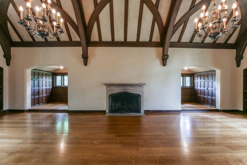Another look at the mansion's ballroom-sized great room with a tall vaulted ceiling with large exposed beams. Images courtesy of Toptenrealestatedeals.com.