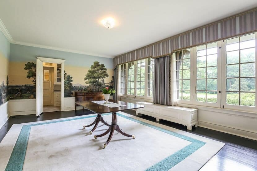 This hall boasts a gorgeous mural on the walls and has a centerpiece table in the middle, set on top of a large area rug. Images courtesy of Toptenrealestatedeals.com.
