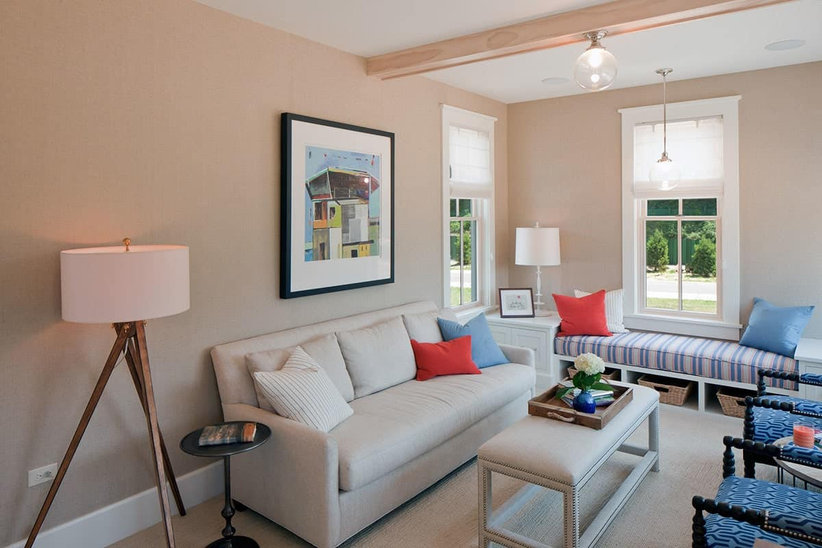 The family is loaded with comfy seats and glass globe pendants hanging from the beamed ceiling.