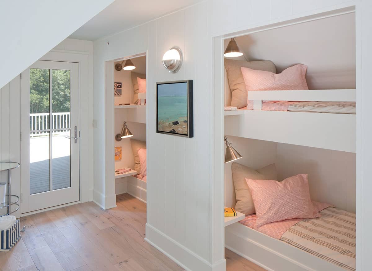 Kid's bedroom with bespoke bunk beds and a glazed door that opens out to the sun deck.