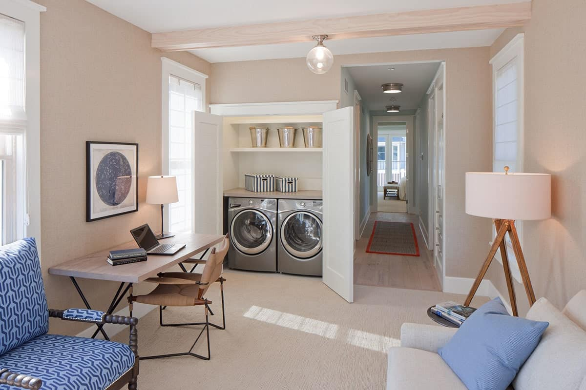 Laundry area across the family room and office. Next to it is the hallway leading to the primary suite.