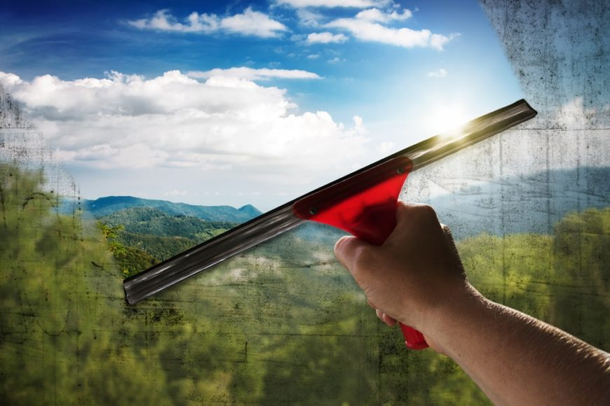 A man cleaning the glass window.