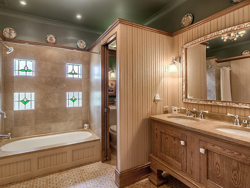 This is quite an elegant bathroom with its patterned walls, yellow wall-mounted lamps and the bathtub that is inlaid on the far wall with the same tone as the walls. Images courtesy of Toptenrealestatedeals.com.