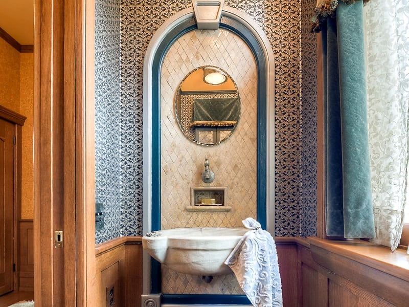 This lovely birdbath sink is paired with patterned blue tiles and an arch giving it a Mediterranean vibe. Images courtesy of Toptenrealestatedeals.com.