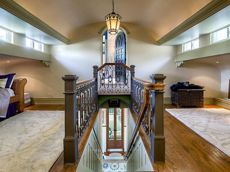 This hall shows the beautifully preserved staircase of the train station topped with an elegant pendant light. Images courtesy of Toptenrealestatedeals.com.