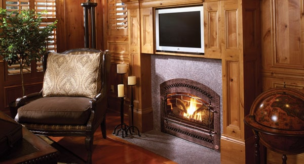 Sitting area by the fireplace with cushioned armchair over the rich hardwood flooring.