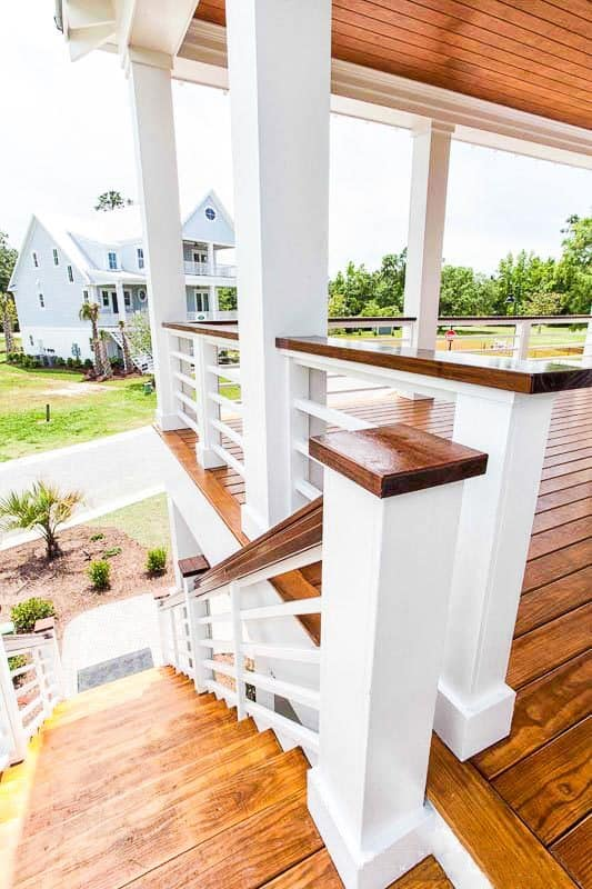 The main level floor plan is accessible via the wooden staircase on the side of the home.