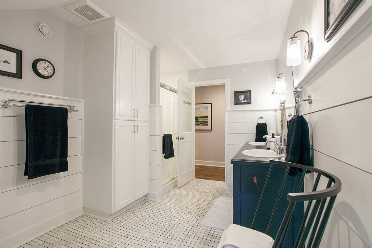 The opposite side view shows the walk-in shower, built-in cabinet, and a stainless steel towel rack.