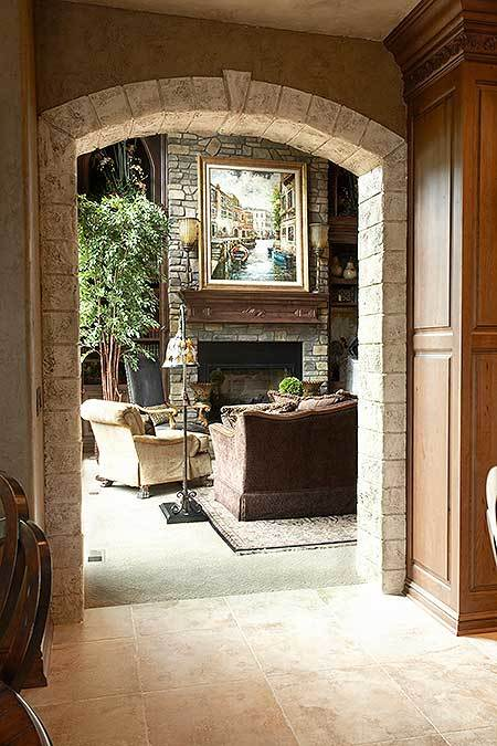View of the living room from the stone archway of the kitchen.