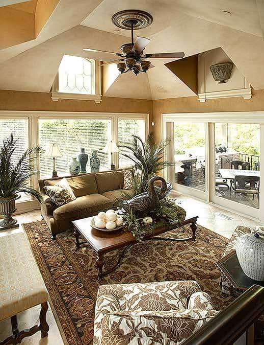 The hearth room has a vaulted ceiling and sliding glass doors that lead out to the covered porch.