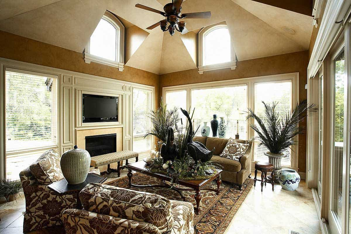 This view shows the fireplace and TV nestled in between the large windows.