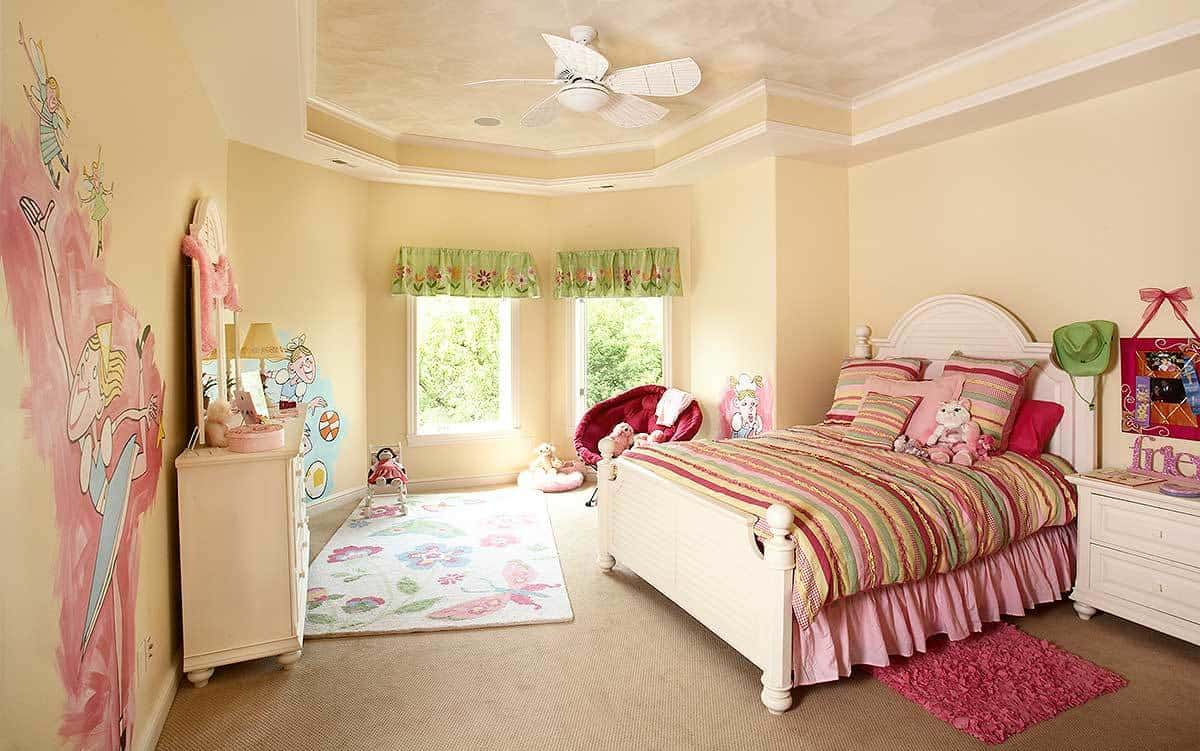 The girl's bedroom has white furnishings, beige carpet flooring and glazed windows dressed in green floral valances.