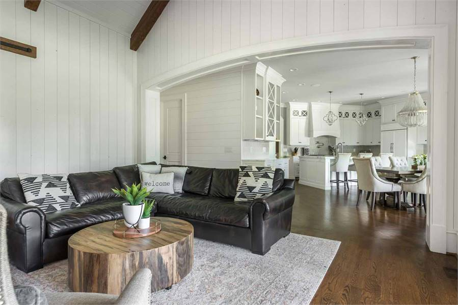 The keeping room is situated across the eat-in kitchen defined by a sleek archway.
