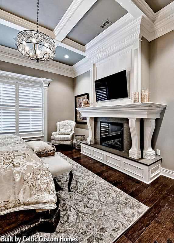 The opposite view shows the romantic fireplace complemented by a wall-mounted TV and wingback chair.