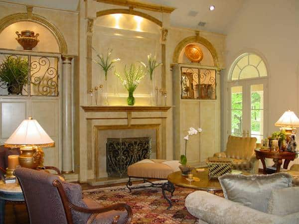 A closer look at the living room shows the cozy seats and a romantic fireplace flanked by arched built-ins.