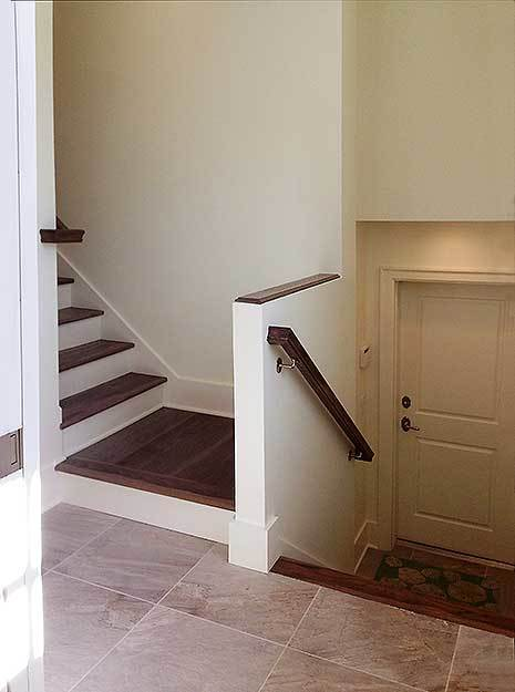 Wooden staircase with marble tiled landing leads to the optional apartment.