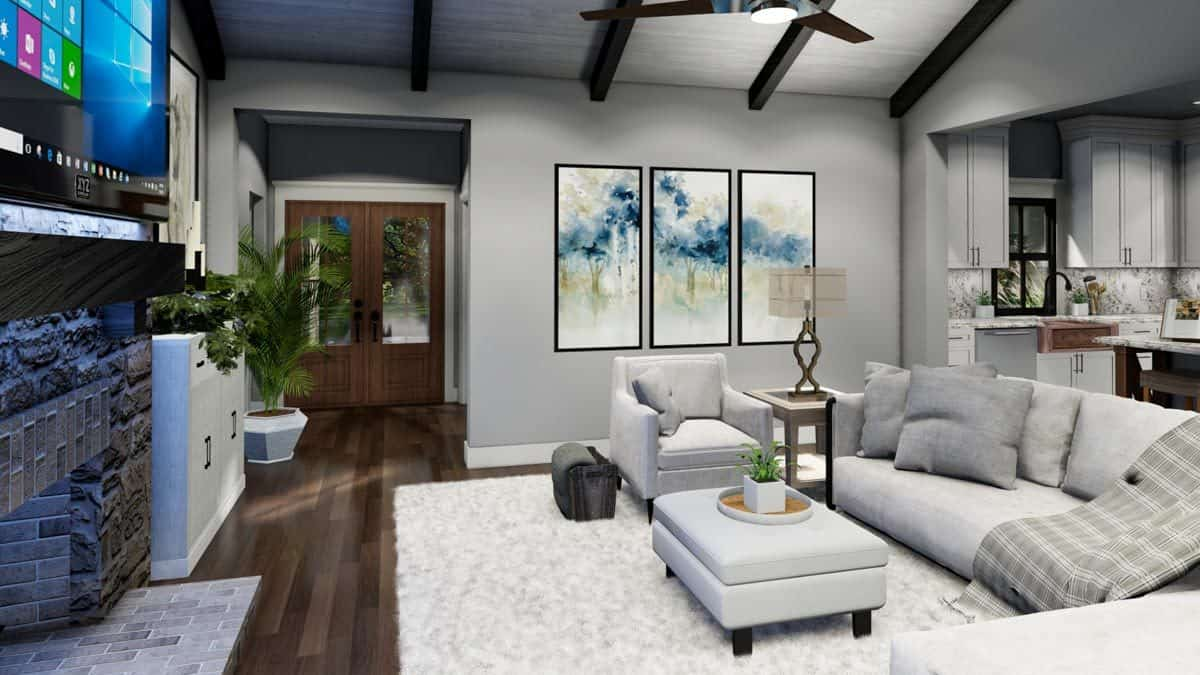 The front french door leads to the foyer and onto the living room with a stone fireplace and gray seats.
