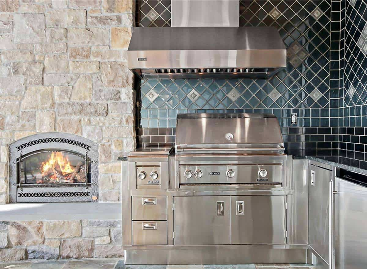 A closeup look at the outdoor kitchen showing the stainless steel appliances and matching cabinets.