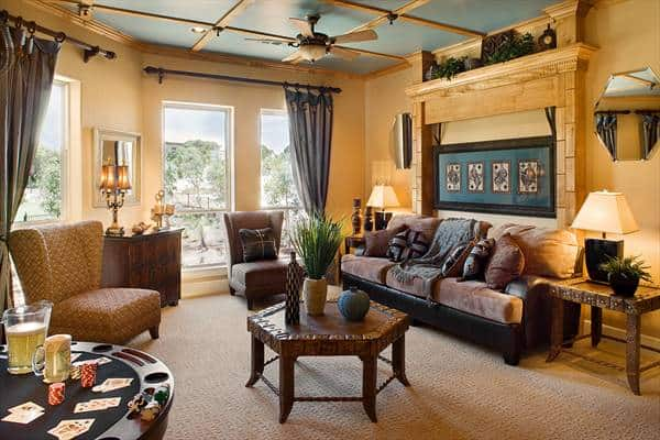 The game room with cozy cushioned seats and a hexagonal coffee table over beige carpet flooring.