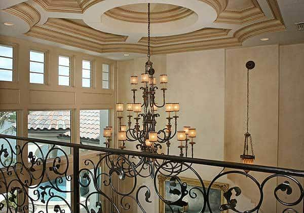 Stylish tray ceiling mounted with a grand chandelier that hangs over the foyer.